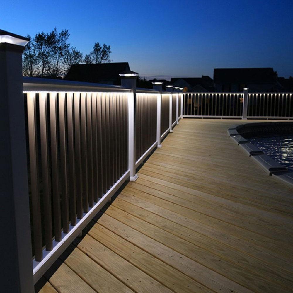 T-Top-Deck-Railing-Kits-with-LED-Post-Cap-and-Under-Rail-Lighting-by-Snavely-International Des idées d'éclairage de terrasse impressionnantes que vous pouvez utiliser chez vous