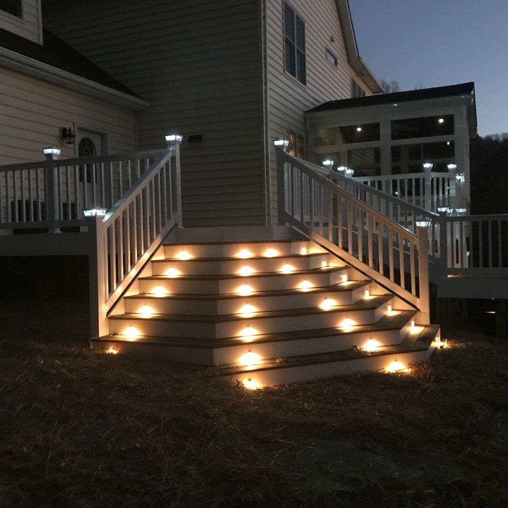 Custom-Designed-Deck-Vinyl-Railings-Solar-Post-Caps-and-Stair-Lights-by-Miracle-Contractors-LLC Impressionnantes idées d'éclairage de terrasse que vous pouvez utiliser chez vous