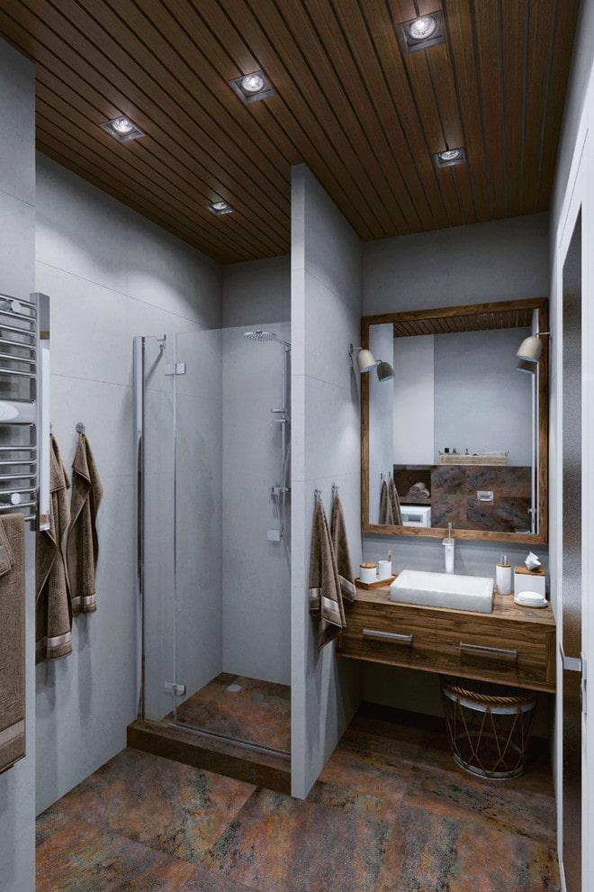 intérieur de la salle de bain dans les tons gris-brun
