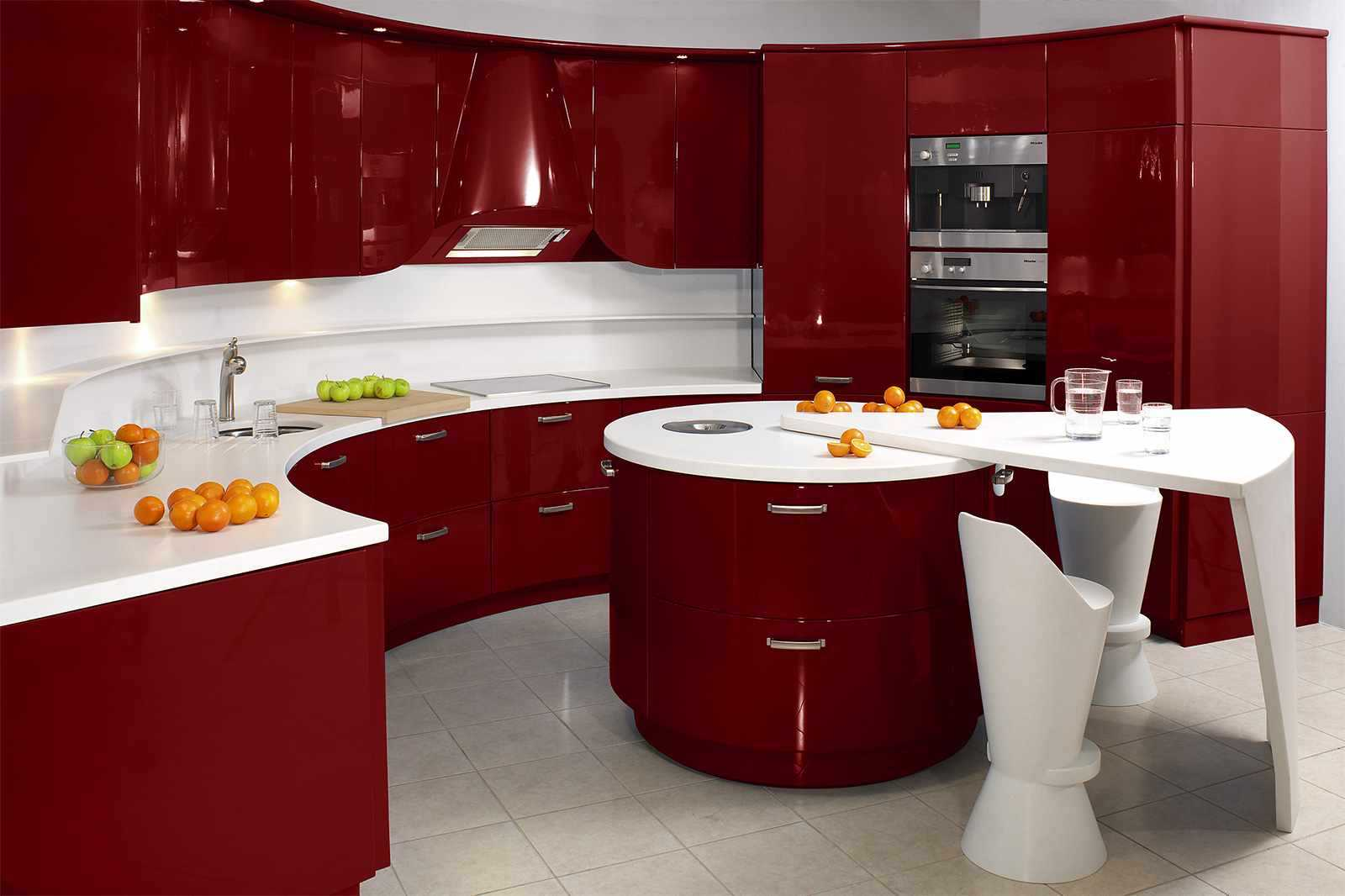 cuisinière à gaz simple-petite-métal-entre-grandes-armoires-de-cuisine-rouges-close-green-wall-paint
