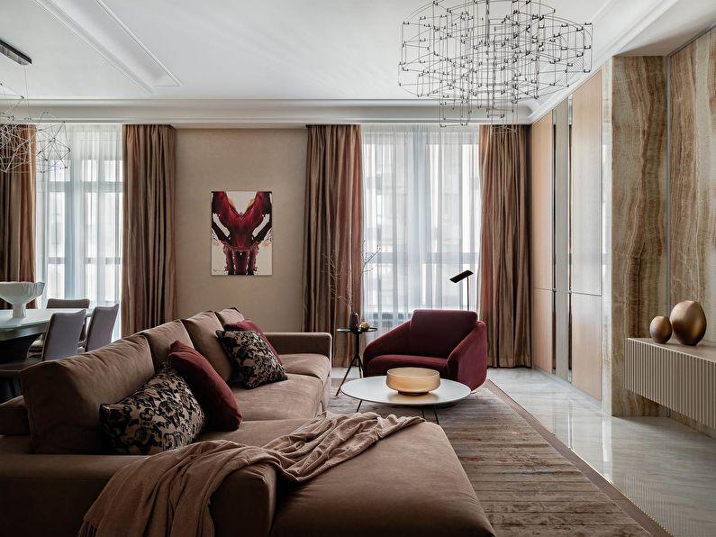 Salon dans des tons terreux tendance avec tapis en terre cuite ALDO