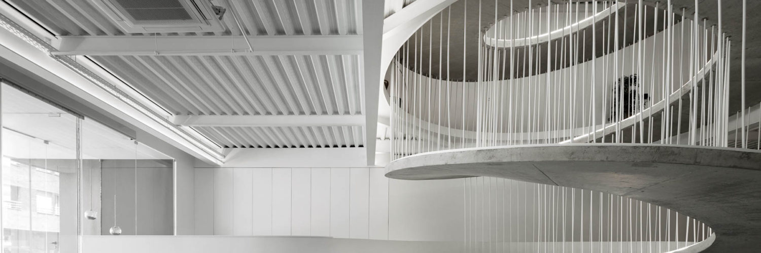 Office stairs as a sculptural piece designed by Paulo Merlini Architects