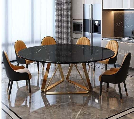 La table ronde en marbre noir est le favori absolu