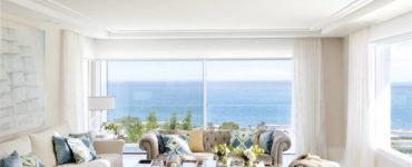 A Beach House With A Very White Base And Color Accents